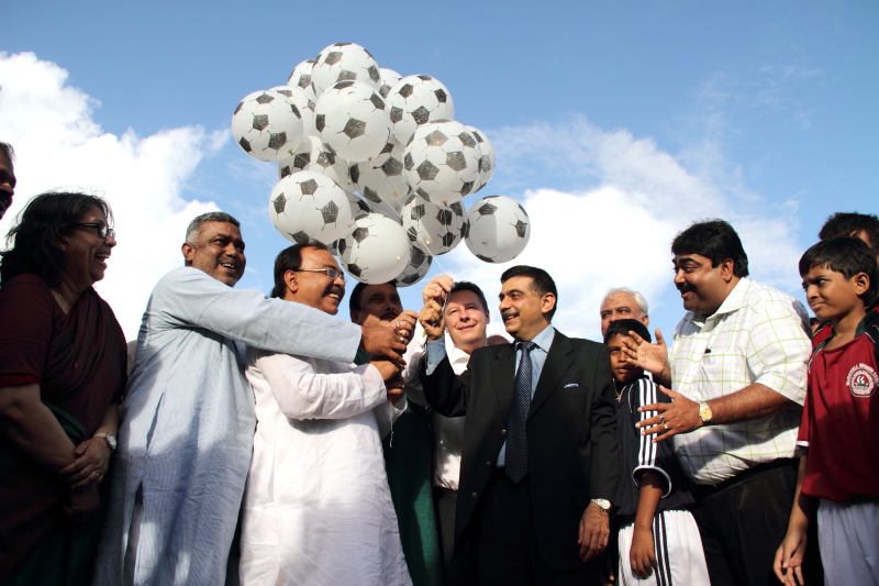 Partners celebrate the launch with football balloons