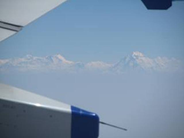 The lofty Himalayan peaks on the way to Delhi from Calcutta