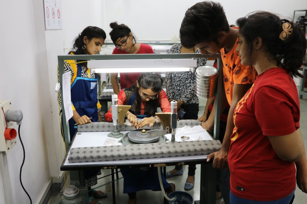 Students demonstrate the art of polishing stones