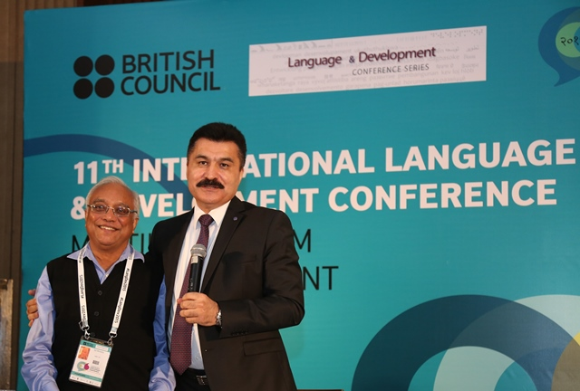 Professor Ajit Mohanty with Alisher Umarov