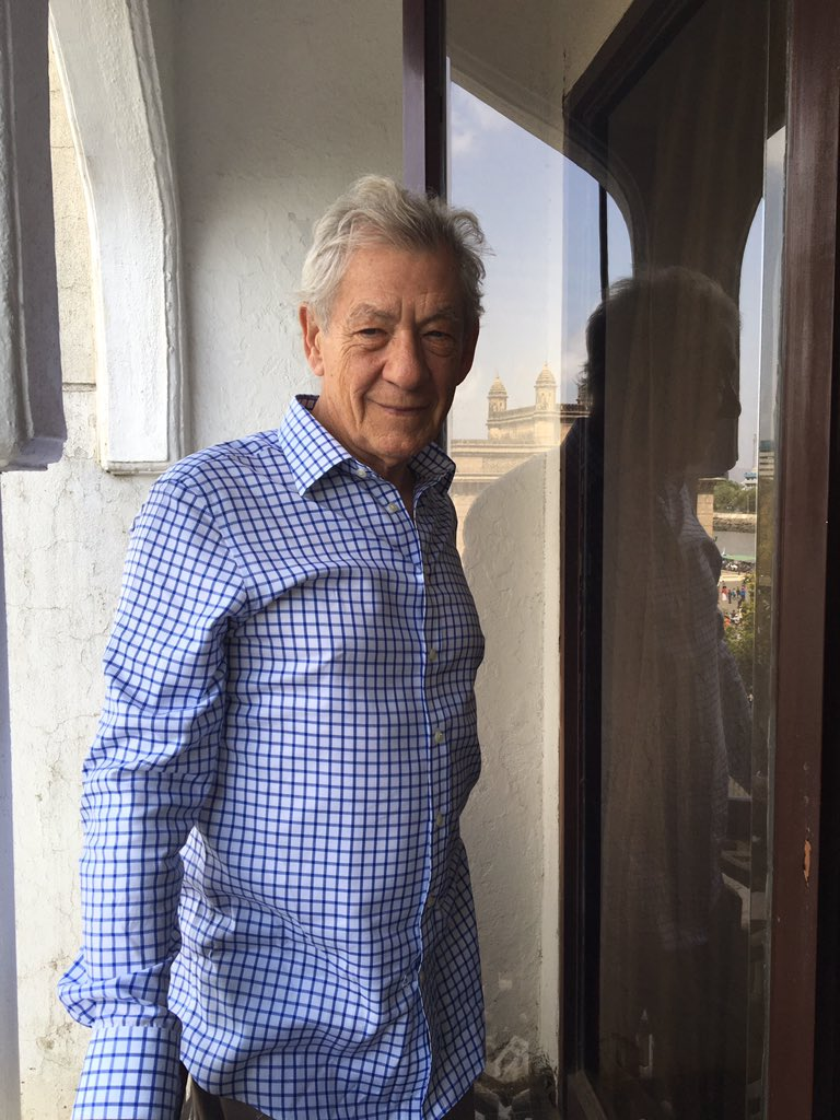Ian McKellen, poses, with the Gateway of India in the reflection, moments before the Twitter chat